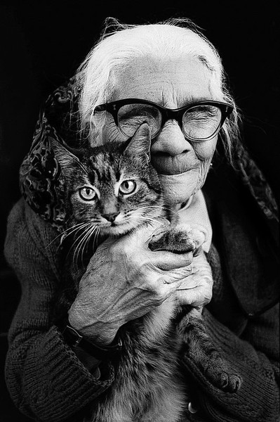 happy old women with cat